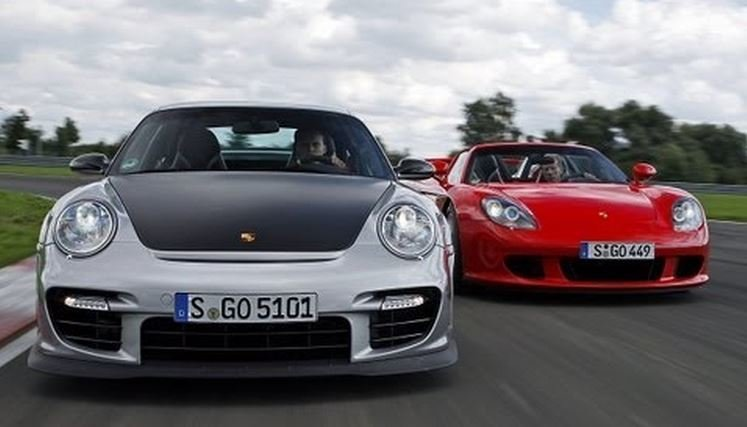 video porsche carrera gt vs 911 gt2 rs. Black Bedroom Furniture Sets. Home Design Ideas
