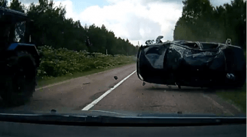 Russische vader redt gezin van rollende Lada