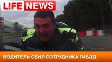 Russische Agent Meegesleurd op Motorkap