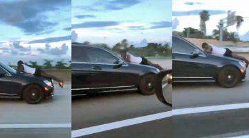 Man-ligt-op-motorkap-van-Mercedes-Benz-op-snelweg