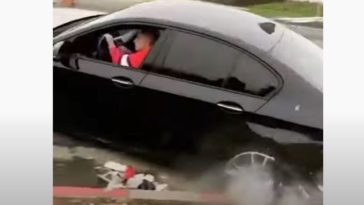 BMW 5-serie crasht tegen stoeprand in rapvideo